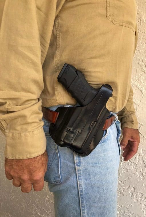 OWB leader holster for gun with tactical light